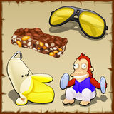 Play set of banana, toys, sweets and sunglasses Royalty Free Stock Photos