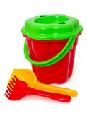 Play set with bucket, shovel and rake on white Stock Photos