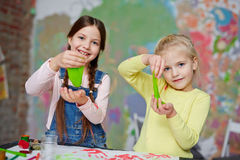 Play with slime. Two friendly girls with slime having fun in kindergarten royalty free stock images