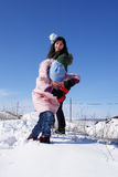 Play snowball. Two girl plays snowball in a sunny day stock photos