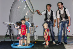 Play with soap bubbles at a children's event in Belarus. For children's parties and events is a favorite pastime of children is to play with soap bubbles, when stock images