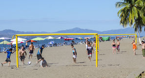 Play soccer on the beach in Puntarenas . Costa Rica. Puntarenas, Costa Rica - February 22, 2015: Costa Rica, boys play soccer on the beach. Goal with guys who stock photo