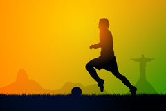 Play soccer. Silhouette soccer players to the sunset time Stock Photos
