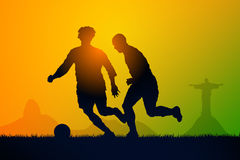 Play soccer. Silhouette soccer players to the sunset time Stock Image