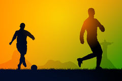 Play soccer. Silhouette soccer players to the sunset time Royalty Free Stock Photo