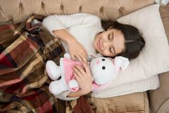 Play soft toy before go sleep. Sleep with toy. Girl enjoy evening time with favorite toy. Kid lay bed and hug bunny toy stock images