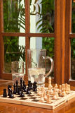 Play Some Chess. Chess board setup in the games room of a coastal resort hotel Stock Images