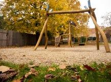 Play space for children autumn longing. Children playground, wooden giraffe, wooden swing stock photos
