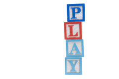 Play spelled out in wooden blocks Stock Photography