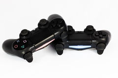 Play station 4 joypad. A couple of dualshock 4 for play station Stock Photography