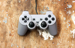 Play station joystick. For controller and play video game on wooden background stock photography
