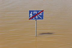 Play street traffic sign in flood Stock Photos