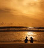 Play in the sunset. Children play in the rays of the setting sun. Legian. Bali. Indonesia Stock Photography