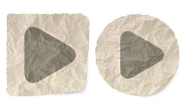 Play symbol. Crumpled slip of paper and a play symbol Royalty Free Stock Photo