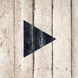 Play Symbol Icon. Media player button icons. Video play button wooden vintage style on rustic background. Play sign painted in black on wooden background. Video stock image