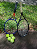 Play a tennis outdoor. Picture of the two rackets and tennis balls on the court outdoor Royalty Free Stock Image