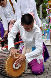 Play Thai Traditional Music. BANGKOK, THAILAND - OCTOBER 2: An unidentified person plays in a Traditional Thai music show during a traditional merit parade of stock photos