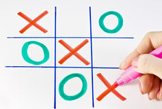 Play tic-tac-toe. Marker in the women's arm and play tic-tac-toe Royalty Free Stock Photo