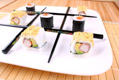Play tic tac toe with sushi and black chopsticks. Close up Royalty Free Stock Images