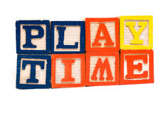 Play Time. The words play time made with wooden blocks, isolated against a white background Royalty Free Stock Photos