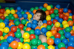 Play time. Adorable little boy smiling in ball pit Stock Photography