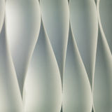 Play time. Background macro image of black and white origami pattern made of curved sheets of paper royalty free stock photo