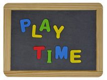 Play time in colored letters on slate Stock Images