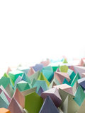 Play time. Colorful abstract geometric background with three-dimensional solid figures. Pyramid Dodecahedron prism rectangular cube arranged on white paper Stock Photo