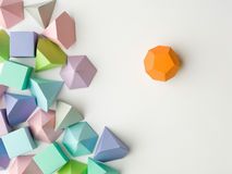 Play time. Colorful abstract geometric background with three-dimensional solid figures. Pyramid Dodecahedron prism rectangular cube arranged on white paper Stock Images
