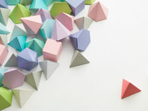 Play time. Colorful abstract geometric background with three-dimensional solid figures. Pyramid Dodecahedron prism rectangular cube arranged on white paper Royalty Free Stock Photography