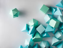 Play time. Colorful abstract geometric background with three-dimensional solid figures. Pyramid Dodecahedron prism rectangular cube arranged on white paper Royalty Free Stock Photo