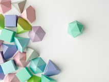 Play time. Colorful abstract geometrical composition. Three-dimensional prism pyramid rectangular cube, dodecahedron on white paper background. Geometry models Stock Photography