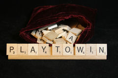Play to Win. Spelled out in scrabble tiles Stock Photography
