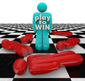 Play to Win Person Last One Standing Winner Game. The words Play to Win on a winner of a competition, the last man or person standing on a chess board or game Stock Photos