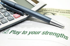 Play to your strengths. Printed on book Royalty Free Stock Image