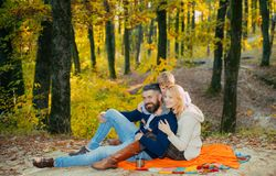 Play together. Mother father and small son play in park. Lovely couple with baby boy play together. Play games. Vacation. And tourism concept. Happy family with royalty free stock photo