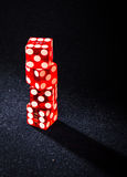 Play with us!. A tower of four dices Royalty Free Stock Photos