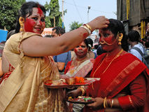 Play With Vermilion. Married Bengali Hindu women smear and play with vermilion during Sindur Khela traditional ceremony on the final day of Durga Puja festival Royalty Free Stock Images