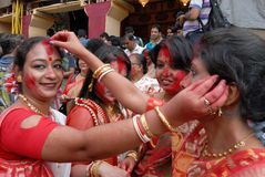 Play With Vermilion. Married Bengali Hindu women smear and play with vermilion during Sindur Khela traditional ceremony on the final day of Durga Puja festival Stock Image