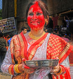 Play With Vermilion. Married Bengali Hindu women smear and play with vermilion during Sindur Khela traditional ceremony on the final day of Durga Puja festival Royalty Free Stock Photography