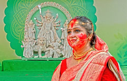 Play With Vermilion. Married Bengali Hindu women smear and play with vermilion during Sindur Khela traditional ceremony on the final day of Durga Puja festival Stock Photo