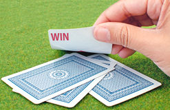 Play and win. Playing cards revealing the word win Royalty Free Stock Photos