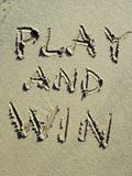 Play and win sport message. Message on the sand beach. Concept for sport game play. Abstract. Play and win - universal message for sport or competition stock photos