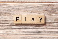 Play word written on wood block. play text on table, concept.  Royalty Free Stock Images