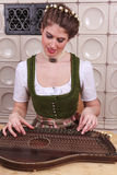 Play Young Bavarian girl in Zither Stock Image