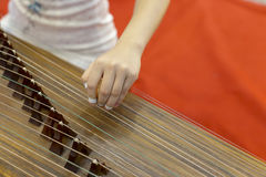 Play the zither. Actress playing the chinese guqin Royalty Free Stock Photos