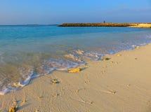 Playa, arena, océano y puesta del sol Fotos de archivo libres de regalías