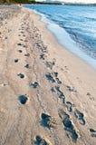Playa, arena y agua Foto de archivo libre de regalías