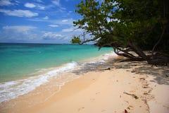 Playa asoleada Imágenes de archivo libres de regalías
