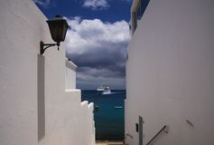PLAYA BLANCA, LANZAROTE - JUNE 14. 2019: View along white walls of house on ferry arriving from Fuerteventura stock photo
